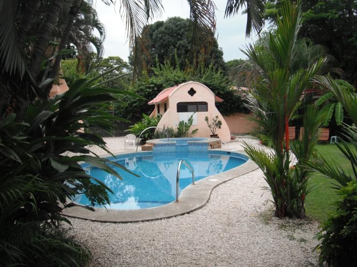 View of swimming pool from hotel room window in Samara, Costa Rica