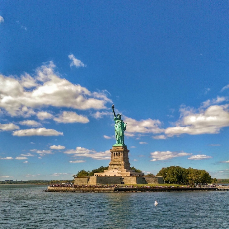 Statue of Liberty on a clear sunny day from the Hudson River