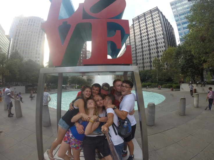 Group of friends, taking a selfie at the love sign in love park, Philadelphia