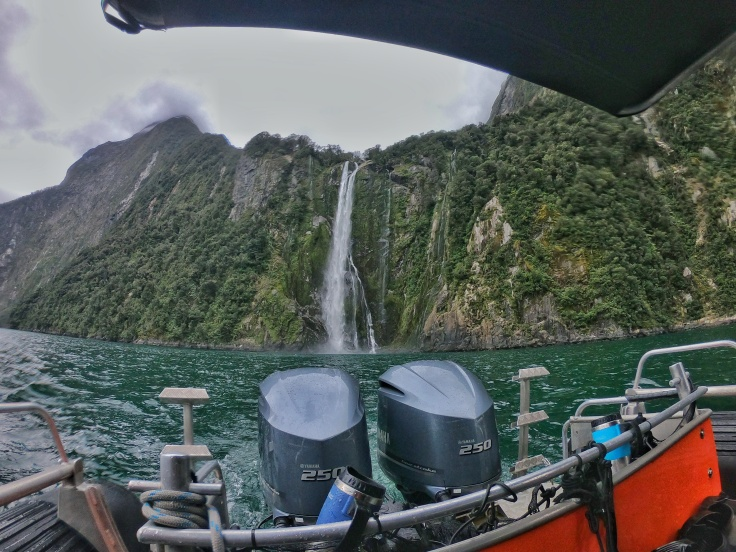 Twin 250 boat engines with the backdrop of a waterfall in Milford Sound